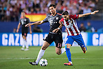 Yannick Carrasco of Atletico Madrid competes for the ball with Xabi Alonso of FC Bayern Munich during their 2016-17 UEFA Champions League match between Atletico Madrid vs FC Bayern Munich at the Vicente Calderon Stadium on 28 September 2016 in Madrid, Spain. Photo by Diego Gonzalez Souto / Power Sport Images