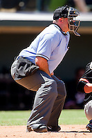 Home plate umpire Craig Barron during an International League game between the Norfolk Tides and the Charlotte Knights at Knights Stadium July 5, 2010, in Fort Mill, South Carolina.  Photo by Brian Westerholt / Four Seam Images