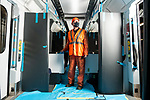 Pictured: Tony Long, a maintenance fitter for South West Trains stands inside the carriage of the new  British Rail Class 484 Island Line train at the workshop at Ryde St Johns Road train station, Isle of Wight after the previous fleet, the british Rail CLass 483 served its last passenger service on Sunday 3rd January 2021 ahead of being delivered to te Isle of Wight Steam Railway as the line prepares to unveil a new fleet of London Underground trains in the spring. <br /> <br /> The trains, which previously served the London Underground's Northern Line are estimated to have travelled over 3 million miles in their 82 years of service. The Island Line is currently undergoing 3 months of refurbishment ahead of unveiling a new fleet of trains, five British Rail Class 484, extensively refurbished by Vivarail.<br /> <br /> The previous two fleet service will see the train (pictured) being delivered to the Isle of Wight Steam Railway, and the other to the London Traction Transport Group with the intention of running it on the Epping Ongar Railway.<br /> <br /> In keeping with Island Line's traditions, the Class 484 trains are former London Underground trains which served on the District Line and will modernise the service on the island.<br /> <br /> © Jordan Pettitt/Solent News & Photo Agency<br /> UK +44 (0) 2380 458800