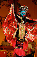 Ancient Chinese art of face-changing at Sichuan Opera, Chengdu, China. In a split second, with a wave of the hand or body spin, the face mask  changes to a different color and expression. Often a series of four or five changes in as many seconds, even on stick-puppets.