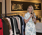 Emily Farren Wieczorek speaks during Reno Magazine's Fall Fashion Styling at the Whispering Vine Wine Co. on Saturday, August 19, 2017.