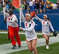 The University of Miami Hurricanes cheerleaders lead the team onto the field. The Miami Hurricanes football team defeated the Pitt Panthers 16-12 in a game at Heinz Field, Pittsburgh, Pennsylvania on October 26, 2019.