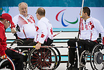 Sochi, RUSSIA - Mar 10 2014 -  Jim Armstrong, Dennis  Thiessen and Mark Ideson discusse strategy between ends during Canada vs USA in Wheelchair Curling round robin play at the 2014 Paralympic Winter Games in Sochi, Russia.  (Photo: Matthew Murnaghan/Canadian Paralympic Committee)