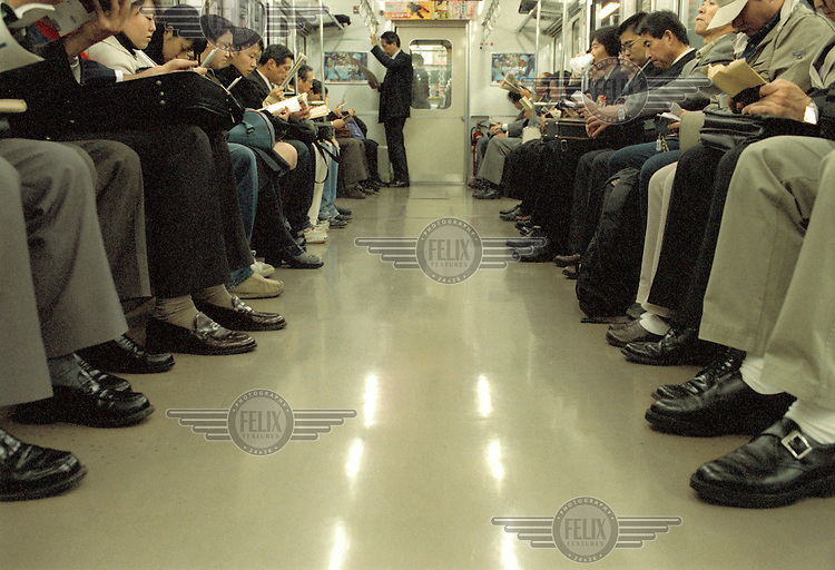 Commuters on an underground metro train.