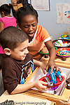 Education preschool 4-5year olds conflict angry girl grabbing toys from classmate vertical
