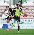 Pars' Stephen Husband (left) and Callum Morris (top) challenge Stranraer's Ryan Borris for the ball.