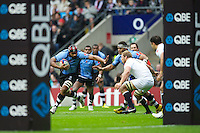 Akapusi Qera of the Flying Fijians looks to hand off Chris Robshaw of England during the QBE International between England and Fiji at Twickenham on Saturday 10th November 2012 (Photo by Rob Munro)