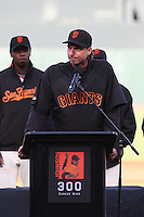 SAN FRANCISCO - JUNE 20:  Randy Johnson speaks during ceremonies honoring Johnson for winning his 300th game before the game between the San Francisco Giants and the Texas Rangers at AT&T Park in San Francisco, California on Saturday, June 20, 2009.  The Giants defeated the Rangers 2-1.  Photo by Brad Mangin