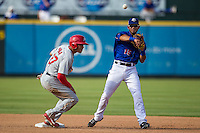 Round Rock Express shortstop Luis Sardinas (15) turns a double play as Memphis Redbirds base runner Thomas Pham (27) slides into second base during the first game of a Pacific Coast League doubleheader on August 3, 2014 at the Dell Diamond in Round Rock, Texas. The Redbirds defeated the Express 4-0. (Andrew Woolley/Four Seam Images)