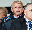 Scotland boss Gordon Strachan takes his seat in the stand at Dens Park.