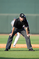 Umpire Mike Provine handles the calls on the bases during the Carolina League game between the Wilmington Blue Rocks and the Winston-Salem Dash at BB&T Ballpark on July 6, 2014 in Winston-Salem, North Carolina.  The Dash defeated the Blue Rocks 7-1.   (Brian Westerholt/Four Seam Images)