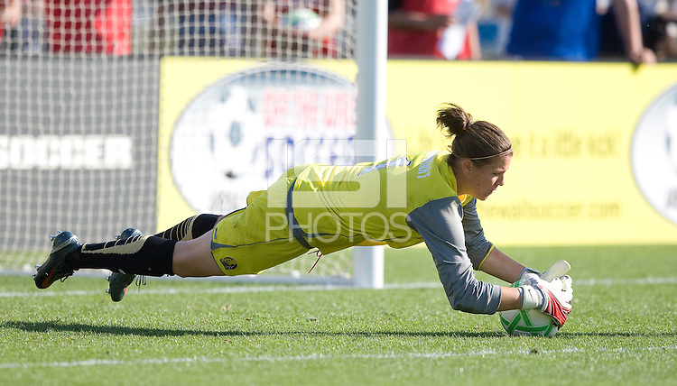 Nicole Barnhart dives for a save. FC Gold Pride defeated the Boston Breakers 2-1 at Buck Shaw Stadium in Santa Clara, California on April 5th, 2009.