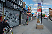Covid-19 pandemic.  Closed shops and businesses on Camden Hight Street during coronavirus lockdown.