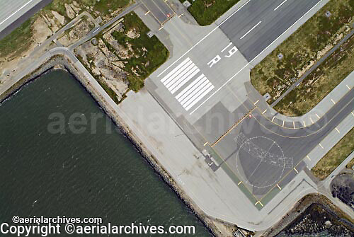 aerial photograph of threshold and approach end of runway 19 right at the edge of the water San Francisco International airport SFO