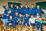 Na Gaeil footballers celebrating their All Ireland Junior championship win in the clubhouse on Saturday night.