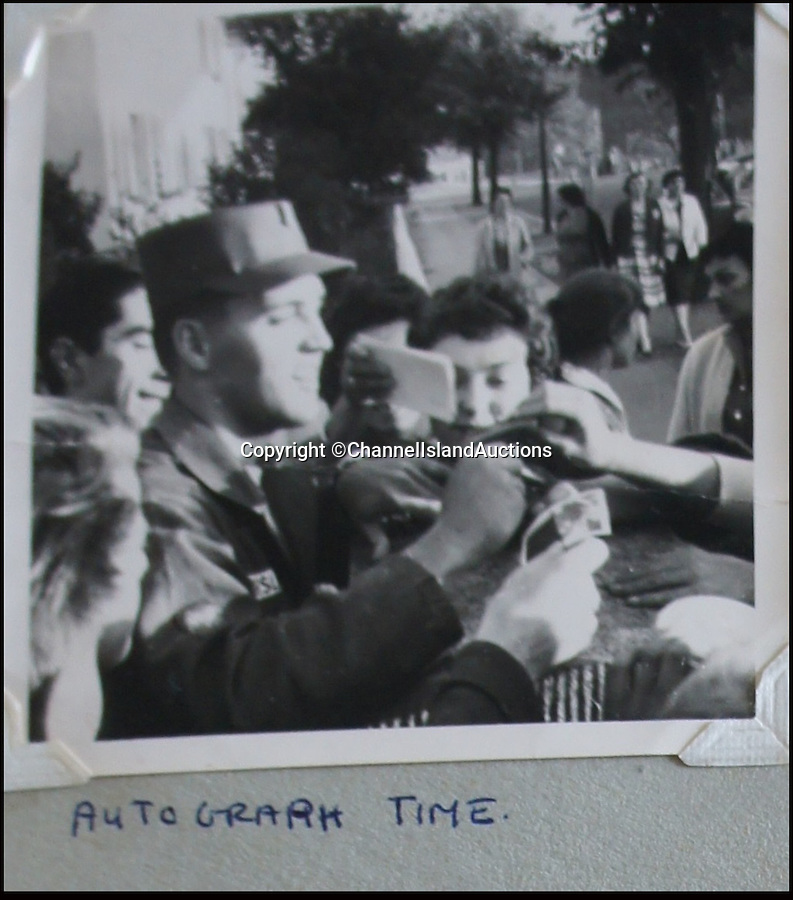 BNPS.co.uk (01202 558833)<br /> Pic: CIA/BNPS<br /> <br /> Elvis was mobbed by fans even in Germany.<br /> <br /> A teenage girl's scrapbook containing unseen photos of Elvis Presley from his military service in Germany has been discovered after lying forgotten in a drawer for years.<br /> <br /> The owner compiled the album dedicated to the 'King' while she was working as a chambermaid in a hotel in Bad Nauheim, where Elvis spent most of his two years' national service.<br /> <br /> The book contains six signed photos of the star in his army uniform, signing autographs and posing with fans, including the owner of the album who was the only English girl in the town.