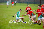 All eyes on the ball as Ballyduff's Kevin Goulding and Darragh Scanlon of St Michaels Foilmore both try to gain possession in the County Senior football league.