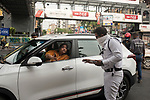 Kolkata police stops a car to find out the reason for moving out of house during 21 days lock down in the country due to covid 19 pandemic. If commuters can not prove a suitable reason they are either sent back to home or being arrested for violating  lock down laws. Kolkata, West Bengal, India. Arindam Mukherjee.