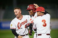 Altoona Curve designated hitter Edwin Espinal (14) is congratulated by teammates Jackson Williams (43) and Chris Diaz (3) after hitting a walk off single during a game against the New Hampshire Fisher Cats on May 11, 2017 at Peoples Natural Gas Field in Altoona, Pennsylvania.  Altoona defeated New Hampshire 4-3.  (Mike Janes/Four Seam Images)