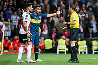 Referee shows yellow card to Boca Juniors Carlos Tevez during  Commebol Final Match between River Plate and Boca Juniors at Santiago Bernabeu Stadium in Madrid, Spain. December 09, 2018. (ALTERPHOTOS/Borja B.Hojas) /NortePhoto.com