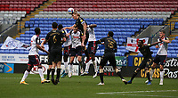 Oldham Athletic's Carl Piergianni out jumps Bolton Wanderers' Eoin Doyle and clears the ball<br /> <br /> Photographer Stephen White/CameraSport<br /> <br /> The EFL Sky Bet League Two - Bolton Wanderers v Oldham Athletic - Saturday 17th October 2020 - University of Bolton Stadium - Bolton<br /> <br /> World Copyright © 2020 CameraSport. All rights reserved. 43 Linden Ave. Countesthorpe. Leicester. England. LE8 5PG - Tel: +44 (0) 116 277 4147 - admin@camerasport.com - www.camerasport.com