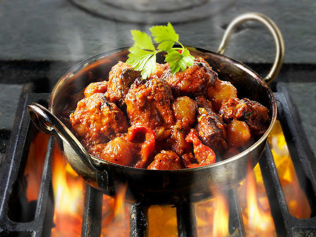 Piri Piri Chicken curry & rice being cooked over hot charcoals , Indian food recipe  pictures, photos & images