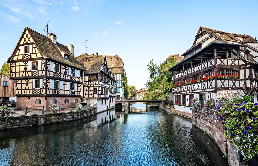 Early morning view down the Ill River in the Petite France section of Strasbourg, Alsace