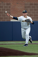 Michigan Wolverines third baseman Jack Van Remortel (51) warms up before the NCAA baseball game against the Michigan State Spartans on May 7, 2019 at Ray Fisher Stadium in Ann Arbor, Michigan. Michigan defeated Michigan State 7-0. (Andrew Woolley/Four Seam Images)