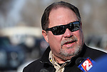 Pershing County Sheriff Richard Machado answers media questions in Lovelock, Nev., on Tuesday, Dec. 10, 2013, after a group of six people were rescued after spending two days in the frigid mountains. (AP Photo/Cathleen Allison)