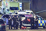 © Joel Goodman - 07973 332324 . 23/05/2017. Manchester, UK. Armed police gather on Trinity Way by the Manchester Arena . Police and other emergency services are seen near the Manchester Arena after reports of an explosion. Police have confirmed they are responding to an incident during an Ariana Grande concert at the venue. Photo credit : Joel Goodman