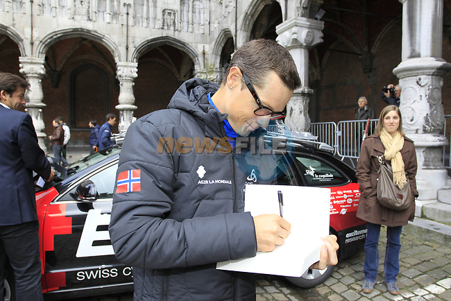 Nicolas Roche (IRL) AG2R La Mondiale signs a copy of his book at the team presentations at the Palais Provincial in Liege city centre before the 98th edition of Liege-Bastogne-Liege 2012. 21st April 2012.  <br /> (Photo by Eoin Clarke/NEWSFILE).