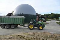Germany, Biogas plant / DEUTSCHLAND, Damnatz im Wendland, Hof und Biogasanlage von Horst Seide, John Deere Traktor mit Dieselantrieb, Anlieferung Maissubstrat