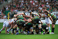 The Saints front row (L-R) of Soane Tonga'uiha, Dylan Hartley and Brian Mujati scrum down during the Aviva Premiership match between Northampton Saints and Exeter Chiefs at Franklin's Gardens on Sunday 9th September 2012 (Photo by Rob Munro)