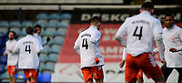 Blackpool players during the pre-match warm-up wearing a t-shirt in tribute to Warren Green, Blackpool's academy manager, who died aged 46<br /> <br /> Photographer Chris Vaughan/CameraSport<br /> <br /> The EFL Sky Bet League One - Peterborough United v Blackpool - Saturday 21st November 2020 - London Road Stadium - Peterborough<br /> <br /> World Copyright © 2020 CameraSport. All rights reserved. 43 Linden Ave. Countesthorpe. Leicester. England. LE8 5PG - Tel: +44 (0) 116 277 4147 - admin@camerasport.com - www.camerasport.com