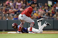 Springfield Cardinals third baseman Alberto Triunfel (5) looks to the umpire after attempting to tag Franklin Rollin (57) sliding in during a Texas League game against the Frisco RoughRiders on May 4, 2019 at Dr Pepper Ballpark in Frisco, Texas.  (Mike Augustin/Four Seam Images)