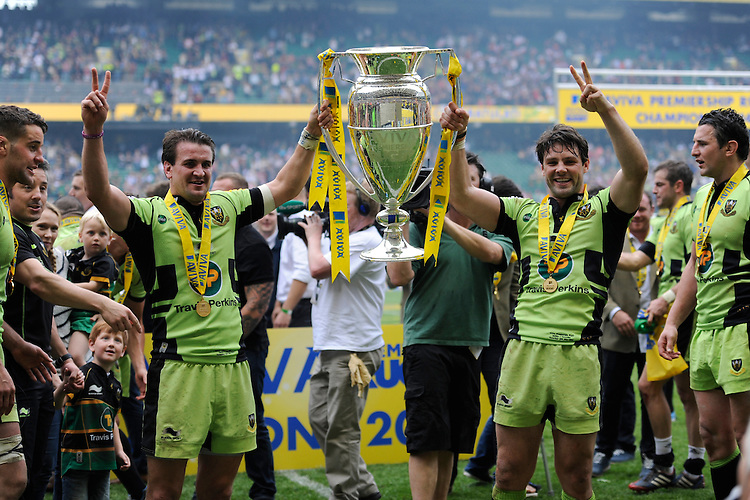 Lee Dickson and Ben Foden of Northampton Saints celebrate with the trophy after winning the Aviva Premiership Rugby Final after extra time against Saracens during the Aviva Premiership Final between Saracens and Northampton Saints at Twickenham Stadium on Saturday 31st May 2014 (Photo by Rob Munro)