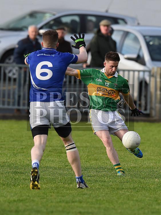 Naomh Mairtin Thomas Sullivan Sean O'Mahony's Steven Fisher. Photo:Colin Bell/pressphotos.ie