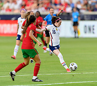 HOUSTON, TX - JUNE 10: Rose Lavelle #16 of the United States takes a shot at the Portugal goal during a game between Portugal and USWNT at BBVA Stadium on June 10, 2021 in Houston, Texas.
