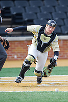 Wake Forest Demon Deacons catcher Garrett Kelly (28) chases after a wild pitch during the game against the Marshall Thundering Herd at Wake Forest Baseball Park on February 17, 2014 in Winston-Salem, North Carolina.  The Demon Deacons defeated the Thundering Herd 4-3.  (Brian Westerholt/Four Seam Images)