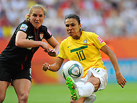 Rachel Buehler (l) of team USA and Marta of team Brazil during the FIFA Women's World Cup at the FIFA Stadium in Dresden, Germany on July 10th, 2011.