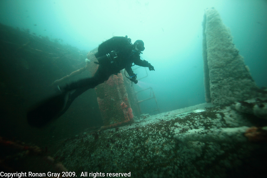Monday, June 21, 2010:  Diver Jay Schwartz of the San Diego Oceans Foundation points to a plaque on the bridge of the HMCS Yukon, a 366ft long Canadian destroyer sunk near Mission Beach.  The wreck which was prepared and sunk for recreational divers to enjoy will have been underwater for ten years in July of this year.