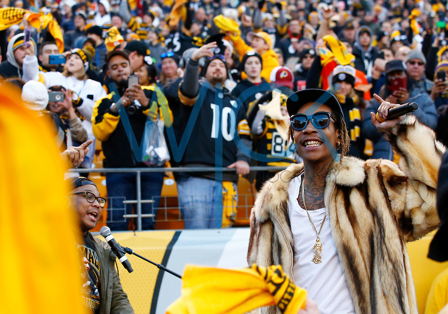 Wiz Khalifa performs prior to the game between the Pittsburgh Steelers and the Denver Broncos game at Heinz Field on December 20, 2015 in Pittsburgh, Pennsylvania. (Photo by Jared Wickerham/DKPittsburghSports)