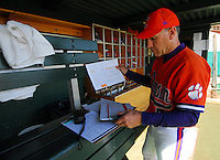 Clemson head coach Jack Leggett handles paper work before the opening game of the 2008 season between Mercer and Clemson University at Doug Kingsmore Stadium, Clemson, S.C. Photo by: Tom Priddy/Four Seam Images