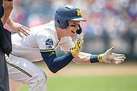 Michigan Wolverines shortstop Jack Blomgren (2) celebrates after reaching third base during Game 11 of the NCAA College World Series against the Texas Tech Red Raiders on June 21, 2019 at TD Ameritrade Park in Omaha, Nebraska. Michigan defeated Texas Tech 15-3 and is headed to the CWS Finals. (Andrew Woolley/Four Seam Images)