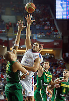 Nenad KRSTIC (Serbia)  shoots over Robertas JAVTOKAS (Lithuania), Mantas KALNIETIS (Lithuania) and Linas KLEIZA (Lithuania) during the 3rd Place World championship basketball match against Lithuania in Istanbul, Serbia-Lithuania, Turkey on Sunday, Sep. 12, 2010. (Novak Djurovic/Starsportphoto.com) .