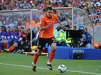 Robin Van Persie dribbles the left flank past a Sony 3D televison camera. Holland defeated Denmark, 2-0, June 14th, at Soccer City in the opening match of Group E of the 2010 FIFA World Cup.