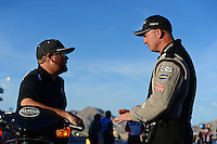 Oct. 27, 2012; Las Vegas, NV, USA: NHRA top fuel driver Shawn Langdon (left) talks with Bob Vandergriff Jr during qualifying for the Big O Tires Nationals at The Strip in Las Vegas. Mandatory Credit: Mark J. Rebilas-