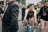 Champs-Elysées stage winner Dylan Groenewegen (NED/LottoNL-Jumbo) escorted to the podium<br /> <br /> 104th Tour de France 2017<br /> Stage 21 - Montgeron › Paris (105km)