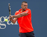 Jo-Wilfried Tsonga (FRA) loses the first two sets against Marin Cilic (CRO) 6-4, 6-4 at the US Open in Flushing, NY on September 8, 2015.