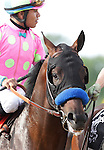 Midnight Interlude, Martin Garcia up, takes part in the post parade before the136th running of the Preakness Stakes at Pimlico Race Course, May 21, 2011. (Joan Fairman Kanes/Eclipsesportswire)